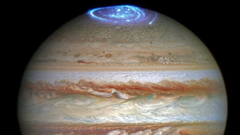 The Hubble Space Telescope captured images of the massive aurora on Jupiter's north pole, visible in ultraviolet light.