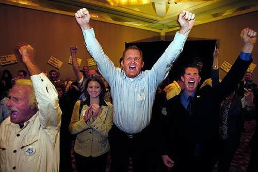 Bob Knoke, of Mission Viejo, Amanda Stanfield, of Monrovia, Jim Domen, of Yorba Linda, and J.D. Gaddis, of Yorba Linda, celebrate returns for Proposition 8 at an Irvine hotel.