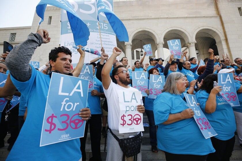 Should Uber and Lyft drivers earn $30 per hour? Los Angeles will study a minimum wage