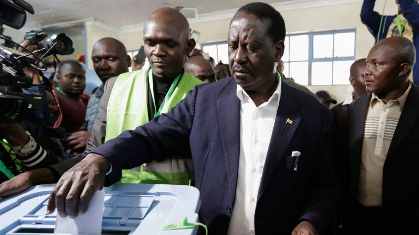 Kenya's opposition leader Raila Odinga casts his ballot at a polling station in Kibera slum, in Nairobi, Kenya, on Tuesday.