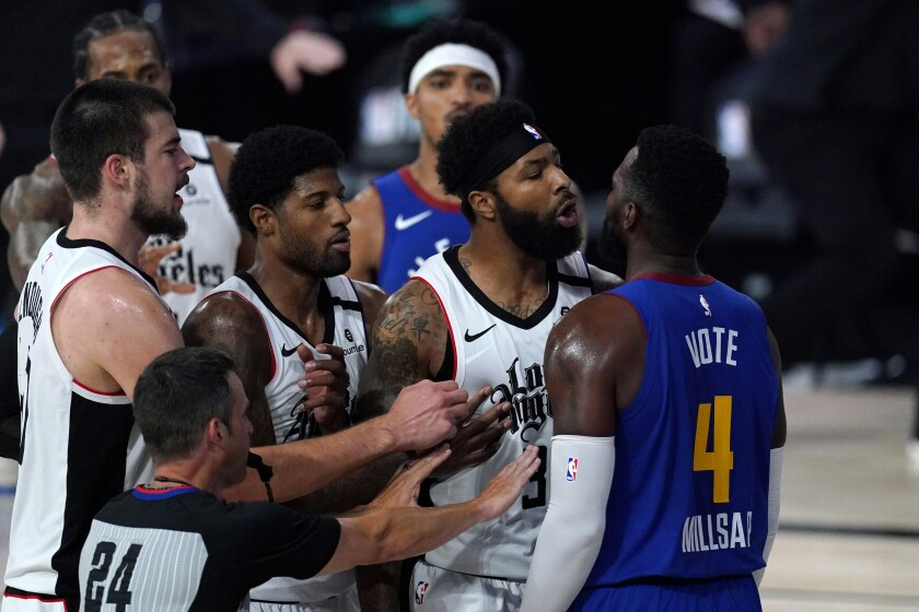 Clippers forward Marcus Morris Sr., center, and Nuggets forward Paul Millsap (4) scuffle during Game 5 on Sept. 11, 2020.