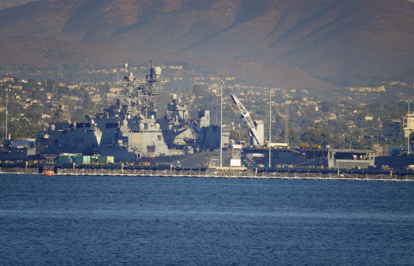 A view of the USS Rushmore (right) docked at Naval Base San Diego