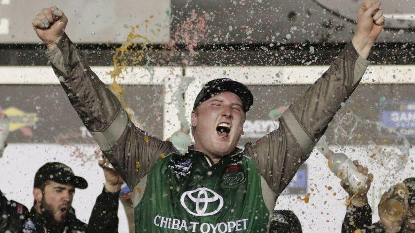 Austin Hill celebrates in Victory Lane after winning a NASCAR Truck Series auto race at Daytona International Speedway on Friday.