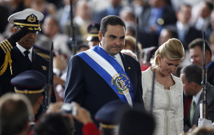 Former El Salvador President Tony Saca and his wife, Ana Ligia de Saca, arrive at the 2009 inauguration ceremony for Mauricio Funes in San Salvador. Funes and a third former president are also being investigated.