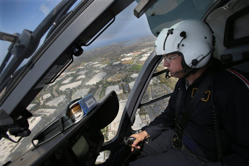 Mercy Air pilot Larry Lockey flies around coastal North County Thursday morning.