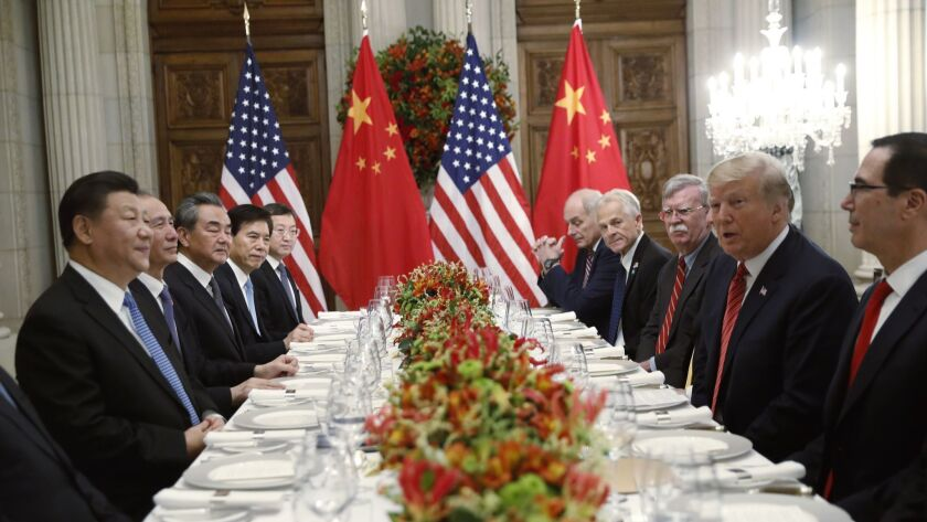 FILE - In this Dec. 1, 2018, file photo, U.S. President Donald Trump, second right, meets with China