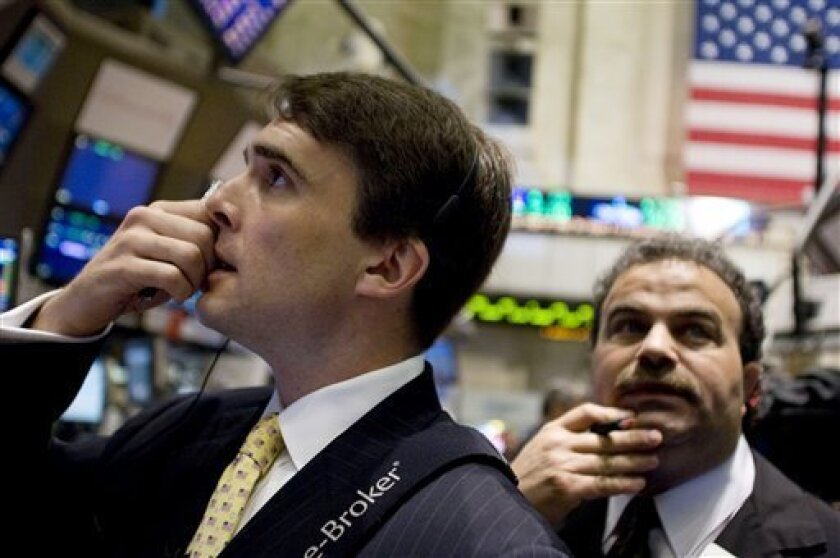 Traders work on the floor of the New York Stock Exchange on Friday, May 1, 2009, in New York. (AP Photo/Jin Lee)