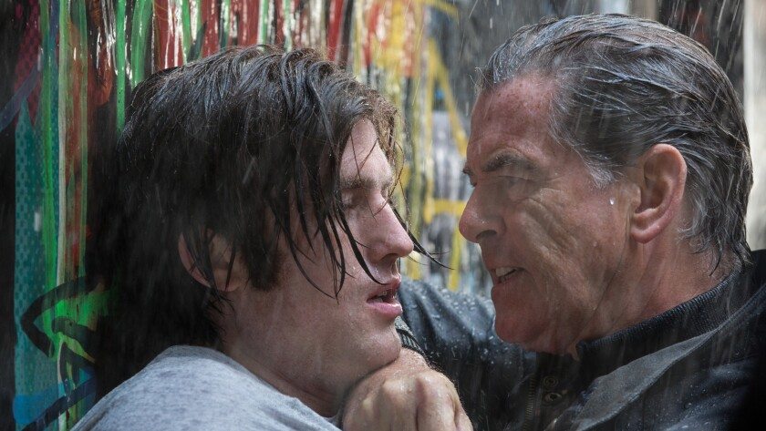 """James Frecheville, left, and Pierce Brosnan in the movie """"I.T."""""""