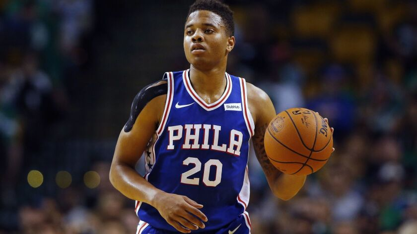 FILE - In this Oct. 9, 2017, photo, Philadelphia 76ers guard Markelle Fultz controls the ball during