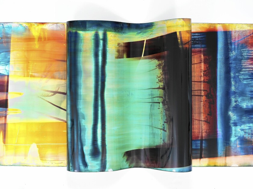 """Mariah Robertson's """"154"""" spans a continuous, 100-foot-long roll of color photographic paper on exhibit at the International Center of Photography in New York."""