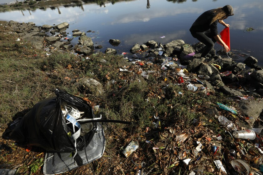 Josey Peters collects trash along Ballona Creek