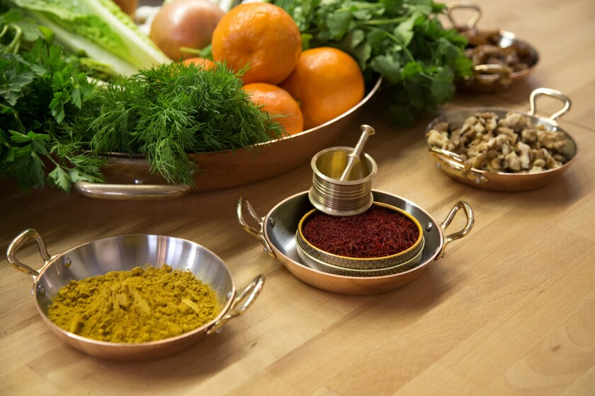 A selection of herbs and other ingredients, including a Persian spice blend and saffron, will go into making dishes for the Persian New Year.