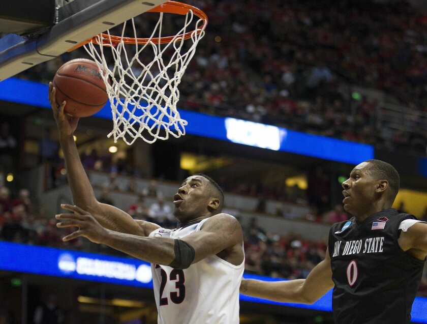 SDSU vs. Arizona in the Sweet 16 game of the NCAA Basketball Tournament. Rpndae Hollis-Jefferson lays in an easy basket as Skylar Spencer defends in the second half.