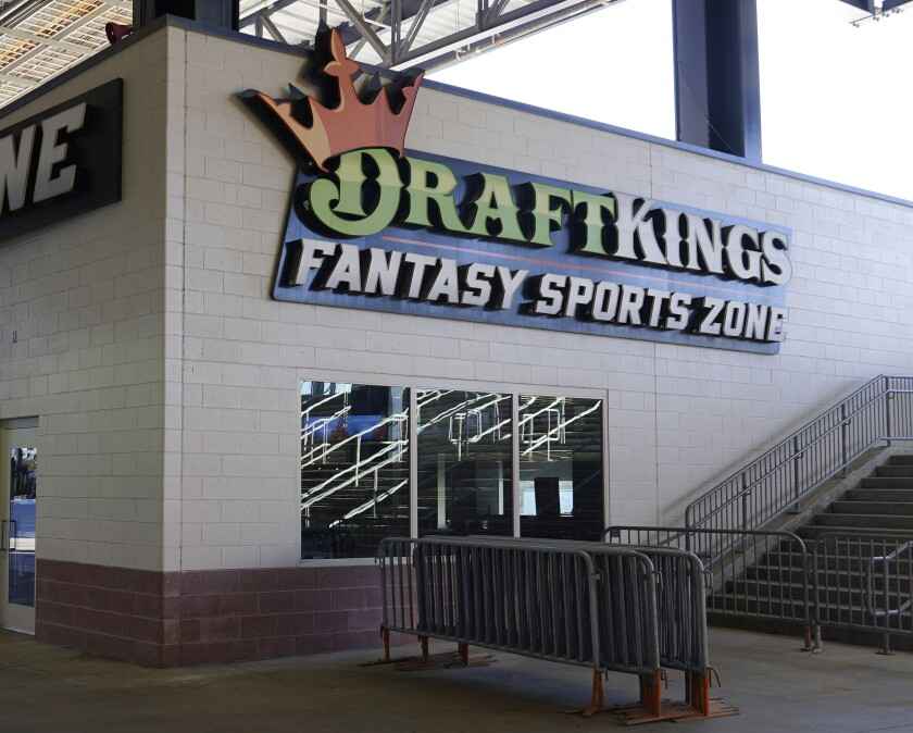 FILE - This Nov. 29, 2020 file photo shows a DraftKings kiosk at Gillette Stadium in Foxborough, Mass. British betting company Entain is confirming that it received a more than $20 billion takeover offer from American rival DraftKings. Entain's stock surged nearly 6% on the London Stock Exchange on Wednesday, Sept. 22, 2021. (AP Photo/Charles Krupa, File)