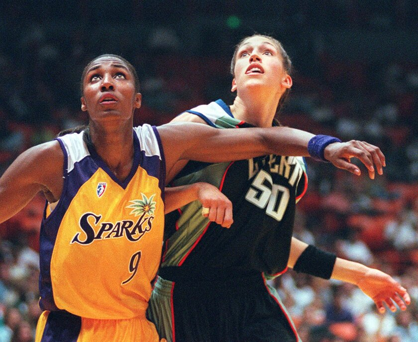 In this June 21, 1997, photo, the Sparks' Lisa Leslie, left, and the New York Liberty's Rebecca Lobo battle.