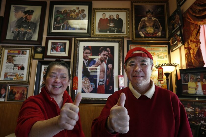 May Flower Restaurant owners Ha and Ha Lu are rooting for Filipino boxing champion Manny Pacquiao, who frequents the restaurant.