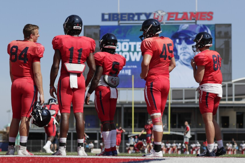 Liberty University football players take the field for an intrasquad scrimmage.