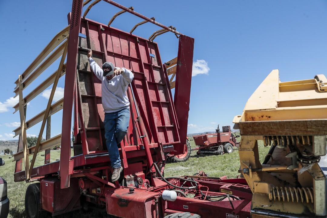 Paul Crawford prepares to run his hay bail retriever.
