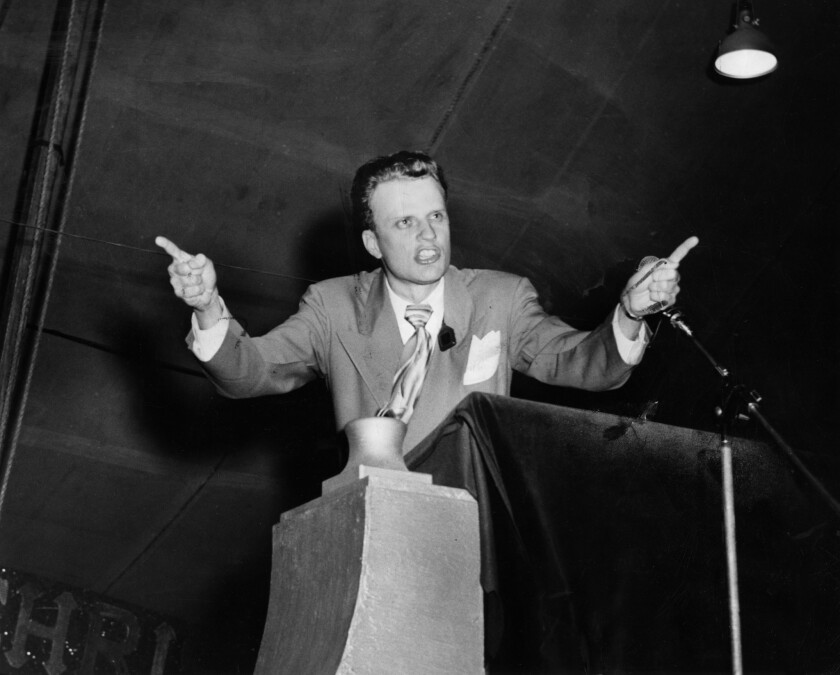 Oct. 30, 1949: Rev. Billy Graham delivers a sermon to a crowd attending a tent revival at Washington Boulevard and Hill Street.