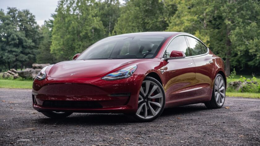 Tesla starts taking orders for shorter-range Model 3 and