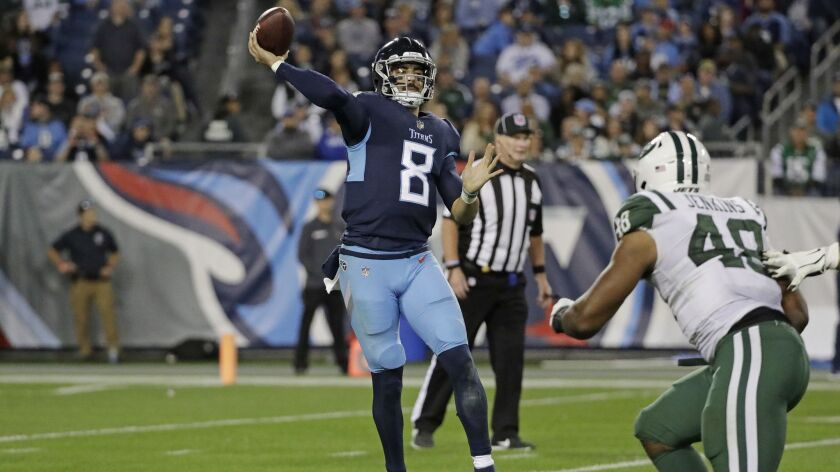 Tennessee Titans quarterback Marcus Mariota (8) passes as he is pressured by New York Jets outside linebacker Jordan Jenkins (48).