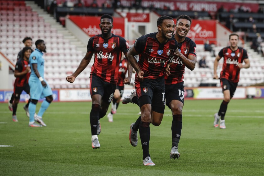 Bournemouth's Callum Wilson, center, celebrates his goal before it was disallowed by VAR during the English Premier League soccer match between Bournemouth and Tottenham at the Vitality Stadium in Bournemouth, England, Thursday, July 9, 2020. (AP photo/Matt Dunham, Pool)