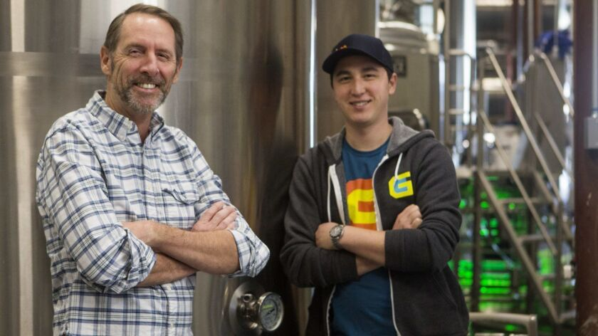 From left, Gamecraft founder Scott Cebula and head brewer Andrew Moy pose for a photograph in Laguna