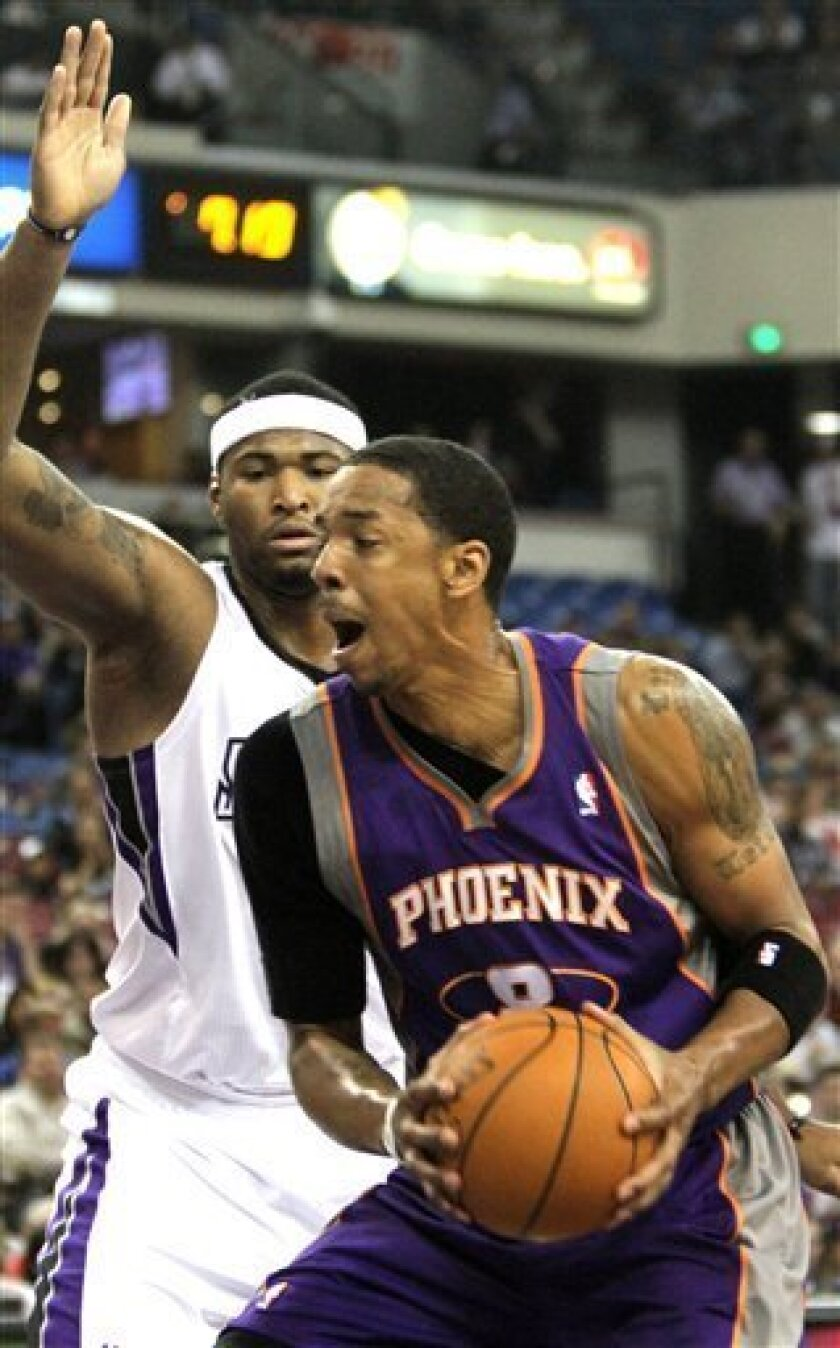 Phoenix Suns forward Channing Frye, right, works against Sacramento Kings center DeMarcus Cousins during the third quarter of an NBA basketball game in Sacramento, Calif., Tuesday, March 29, 2011. (AP Photo/Rich Pedroncelli)