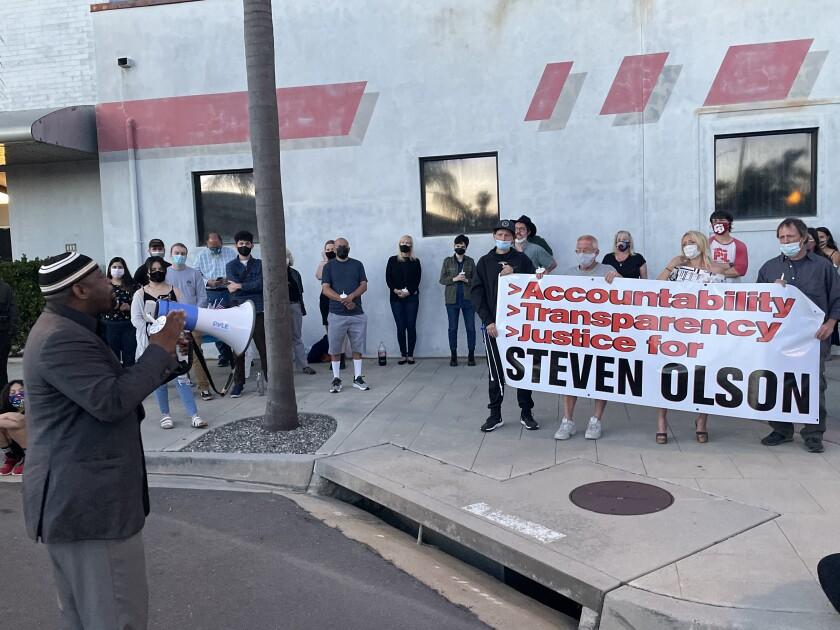 A vigil for Steven Olson in downtown Escondido.