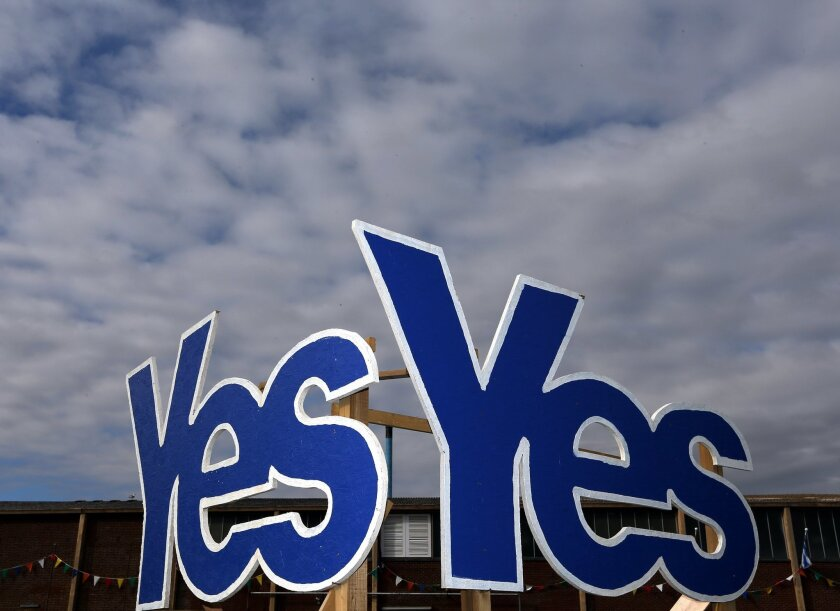 FILE - In this Monday, Sept. 8, 2014, file photo Yes Signs are displayed in Eyemouth, Scotland. As the battle to decide the future of Scotland and the UK enters its final week, both sides have launched some of the largest ad campaigns in Scottish political history. Millions of pounds (dollars) have been spent and thousands of acres of trees sacrificed to produce countless advertising posters and pamphlets, only for the messages they contain to end up being ridiculed and parodied on social media. (AP Photo/Scott Heppell, File)