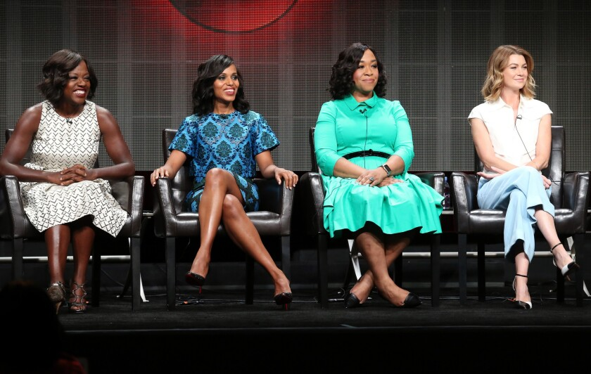 """Actresses Viola Davis, left, Kerry Washington, executive producer Shonda Rhimes and actress Ellen Pompeo speak onstage during the """"Grey's Anatomy,"""" """"Scandal"""" and """"How to Get Away With Murder"""" panel discussion at the ABC Entertainment portion of the 2015 Summer TCA Tour at the Beverly Hilton Hotel on Aug. 4, 2015, in Beverly Hills."""