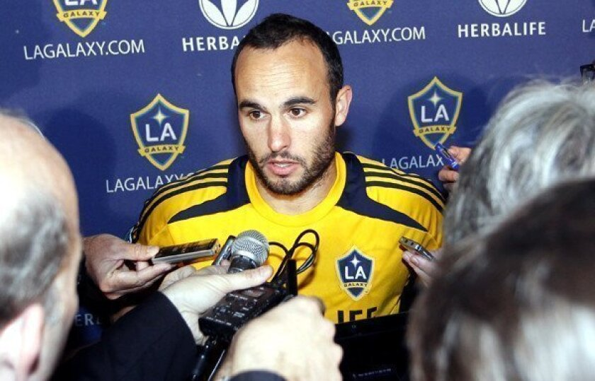 Galaxy star Landon Donovan talks with reporters at a news conference during the MLS Cup playoffs.