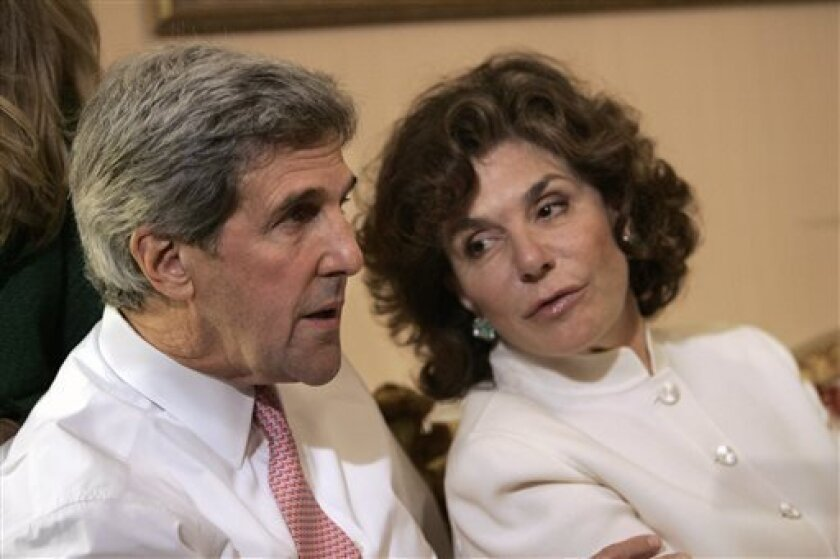 FILE - In a Tuesday, Nov. 4, 2008 file photo, Sen. John Kerry, D-Mass, left, talks with his wife Teresa Heinz Kerry while watching election results at a hotel in Boston, in Boston.  A hospital spokesman says Teresa Heinz Kerry is hospitalized Sunday, July 7, 2013 in critical but stable condition in