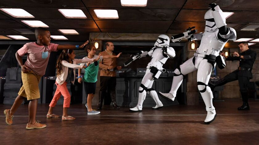 Young passengers on Disney's Fantasy battle Stormtroopers at the new Star Wars Command Post.