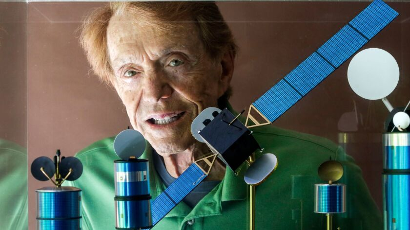 Harold Rosen, shown through a showcase of models of his satellites at his home in Santa Monica in 2013.