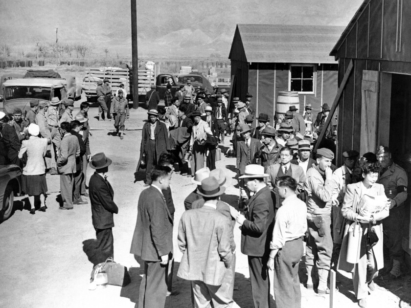 This 1942, photo shows the first arrivals at the Japanese evacuee community established in Owens Valley in Manzanar, Calif.