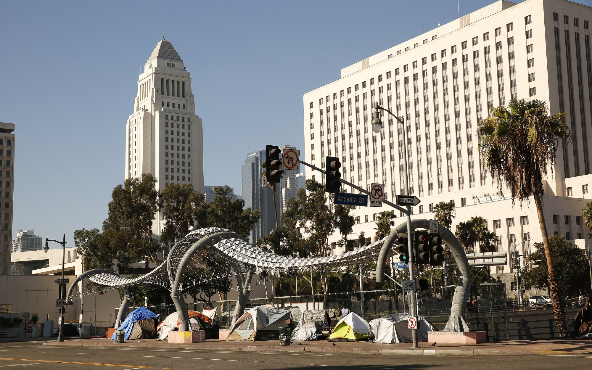 Tents along Los Angeles Street over the 101 Freeway.