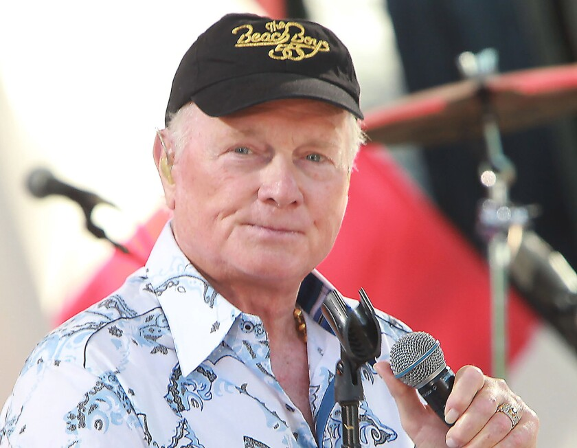 Mike Love of the Beach Boys on stage.