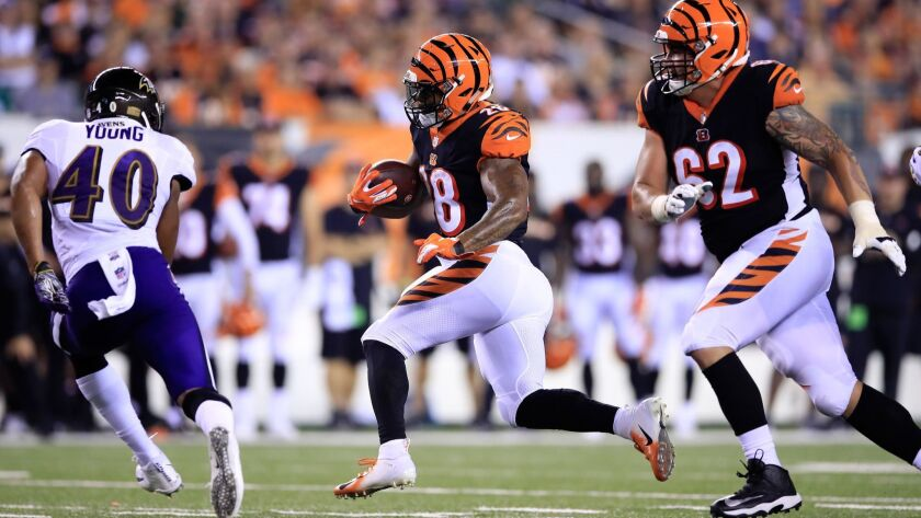 Bengals running back Joe Mixon runs Thursday against Ravens.