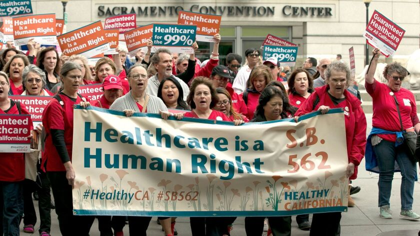 Supporters of single-payer health care march to the Capitol Wednesday, April 26, 2017, in Sacramento