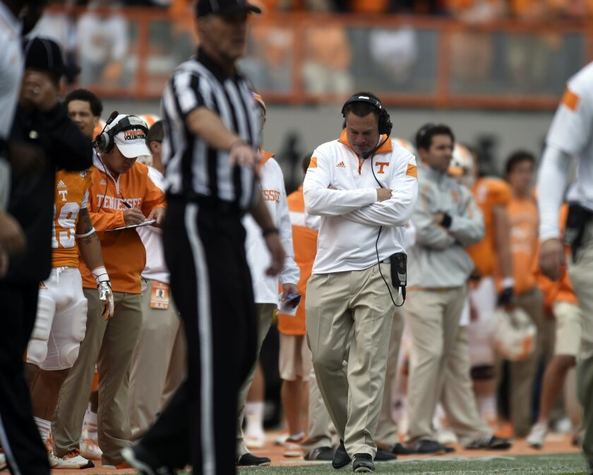 Tennessee coach Butch Jones, center, paces the sideline during the second half of an NCAA college football game against Florida at Neyland Stadium, Saturday, Oct. 4, 2014, in Knoxville, Tenn. (AP Photo/Knoxville News Sentinel, Saul Young)