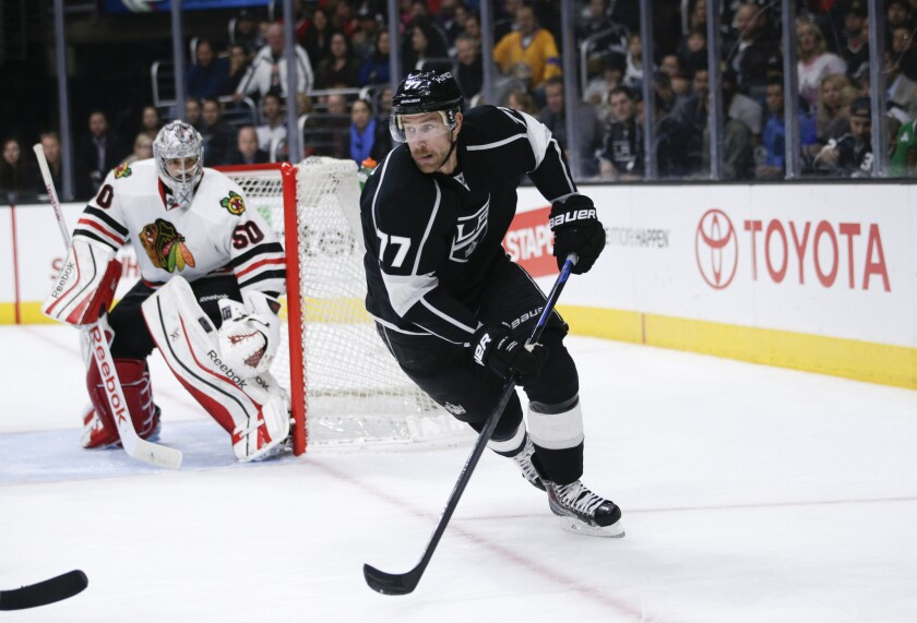Kings center Jeff Carter looks for the puck in the Blackhawks zone earlier this season.