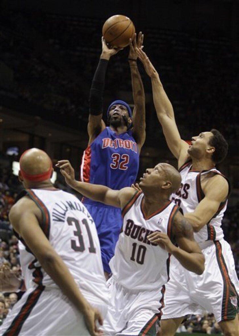 Detroit Pistons' Richard Hamilton (32) shoots over Milwaukee Bucks' Charlie Villanueva (31), Keith Bogans (10) and Dan Gadzuric during the first half of an NBA basketball game Saturday, Feb. 7, 2009, in Milwaukee. (AP Photo/Morry Gash)