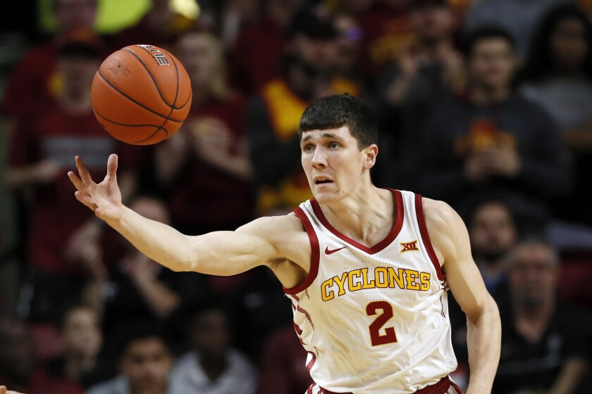 FILE - Iowa State guard Caleb Grill reaches for the basketball during the first half of an NCAA college basketball game against Southern Mississippi in Ames, Iowa, in this Tuesday, Nov. 19, 2019, file photo. Caleb Grill will transfer back to Iowa State after playing last season at UNLV, coach T.J. Otzelberger announced Tuesday, April 13, 2021. (AP Photo/Charlie Neibergall, File)