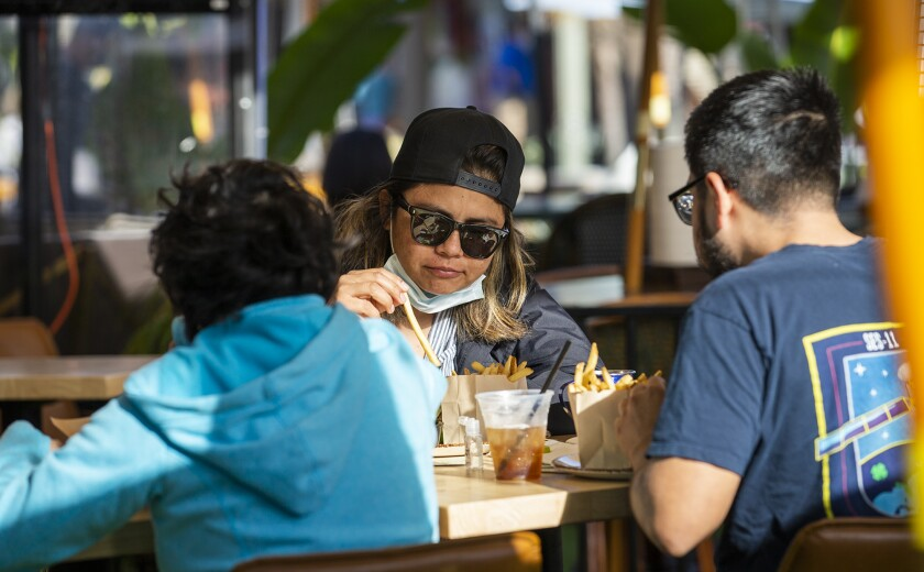 Jasmine Ramirez, left, Fabiola Struchen, center, and Carlos Ramirez have lunch at Killarneys Irish Pub in Huntington Beach.