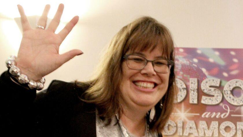 "Dr. Kelly King, Interim Superintendent of Schools, shines like a disco ball at ""Disco & Diamonds"" pr"