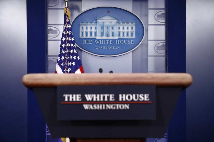 A plaque depicting the White House in the press briefing Room of the White House.