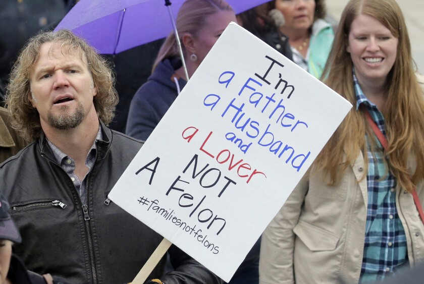 """FILE - In this Feb. 10, 2017, file photo, Kody Brown, left, from TV's reality show """"Sister Wives,"""" marches during a protest at the state Capitol, in Salt Lake City. Polygamists have lived in Utah since before it became a state, and 85 years after the practice was declared a felony they still number in the thousands. It's even been featured in the long-running reality TV show, """"Sister Wives."""" Now, a state lawmaker says it's time to remove the threat of jail time for otherwise law-abiding polygamists. (AP Photo/Rick Bowmer, File)"""