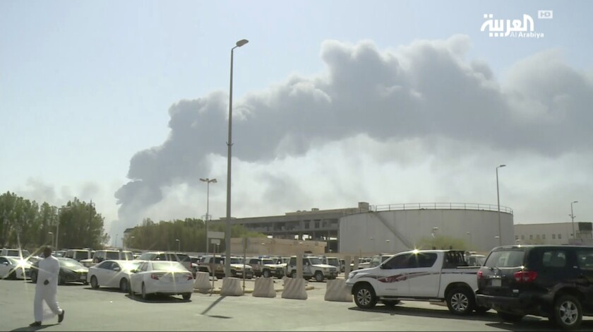 A photo taken from a video broadcast on the Saudi-owned satellite news channel Al-Arabiya shows smoke from a fire at the Abqaiq oil processing facility in Buqayq, Saudi Arabia.