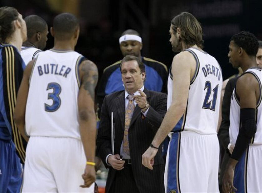Washington Wizards' Flip Saunders, center, talks to his team during a time-out in the first quarter of an NBA basketball game against the Cleveland Cavaliers, Wednesday, Jan. 6, 2010, in Cleveland. (AP Photo/Mark Duncan)
